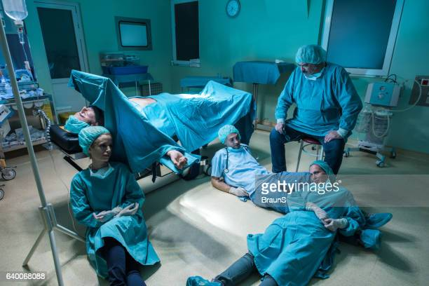 Team of exhausted surgeons after the surgery.