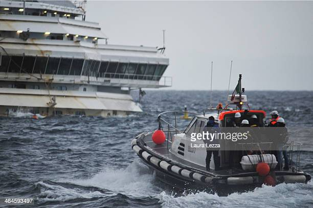 A team of experts go to inspect the wreck of the ship Costa Concordia on January 23 2014 in Isola del Giglio Italy Today for the first time since the...