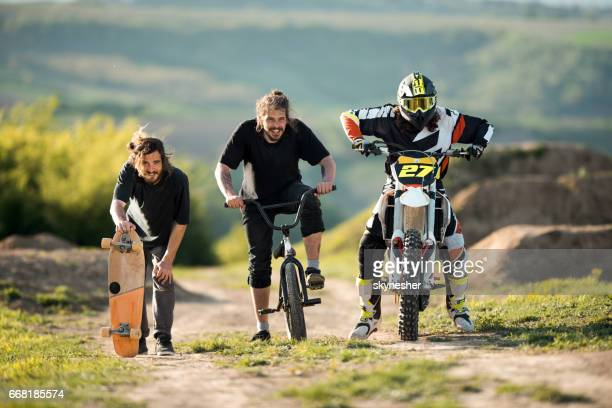 team of extreme sports men preparing for a race in nature. - scrambling stock photos and pictures