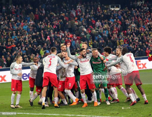 Team of FC Salzburg reacts after the Europa League Round of 16 second leg football match between FC Salzburg and Borussia Dortmund in Salzburg...