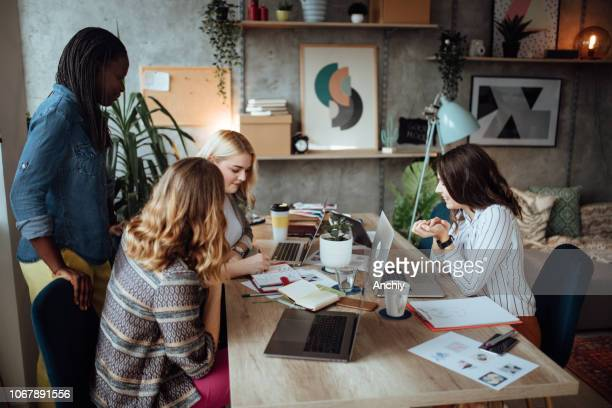 Team of female professionals on a meeting