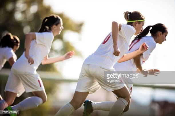 team of female soccer players warming up before the match. - team sport stock pictures, royalty-free photos & images