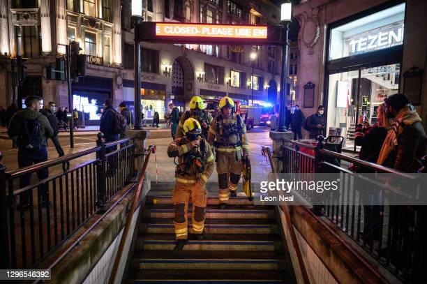 Team of firefighters with breathing apparatus enter Oxford Circus underground station following an emergency alarm on January 15, 2021 in London,...
