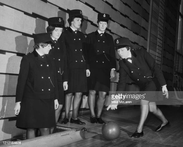 A team of five female Metropolitan Police officers who will soon be competing against men's teams in the National Police Tenpin Bowling Championships...