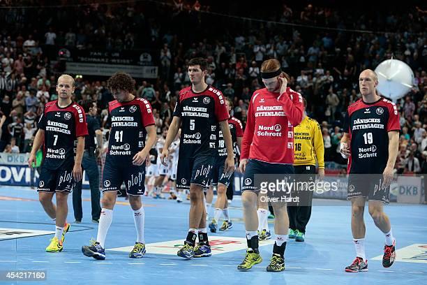 Team of Flensburg appears frustrated after the DKB HBL Bundesliga match between THW Kiel and SG FlensburgHandewitt on August 26 2014 in Kiel Germany