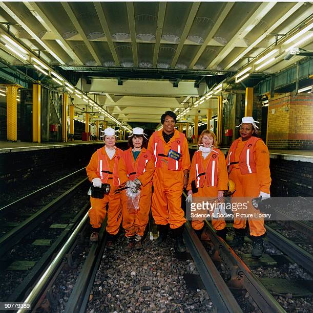 A team of 'fluffers' working at Whitechapel Station on the District Line Although London Transport had a tunnelcleaning train much of the work of...