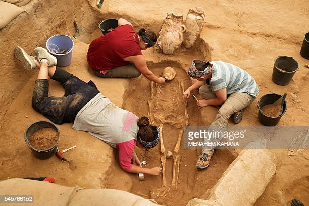 A team of foreign archaeologists extract skeletons at the excavation site of the first Philistine cemetery ever found on June 28 2016 in the...