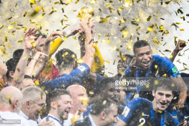Team of France and Kylian Mbappe celebrate the victory with the trophy during the World Cup Final match between France and Croatia at Luzhniki...