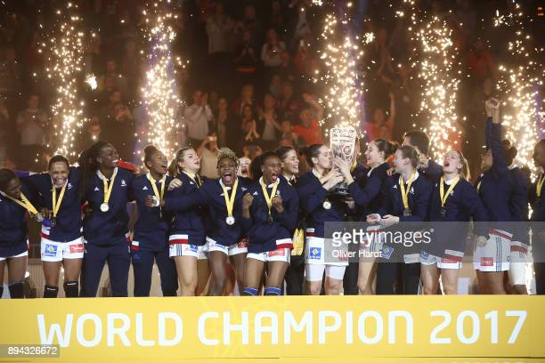 Team of France celebrate after the IHF Women's Handball World Championship final match between France and Norway at Barclaycard Arena on December 17...