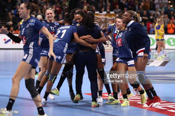 Team of France celebrate after the IHF Women's Handball World Championship Semi Final match between Sweden and France at Barclaycard Arena on...