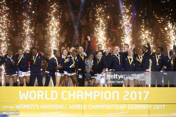 Team of France celebrate with the trophy after the IHF Women's Handball World Championship final match between France and Norway at Barclaycard Arena...