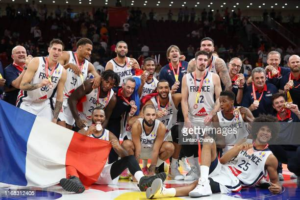Team of France players celebrate winning the FIBA 2019 Basketball World Cup third place match between France and Australia during the 3rd place game...