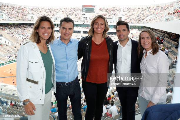 Team of France Televisions TV Chanel Amelie Mauresmo Sports Journalist Laurent Luyat Mary Pierce Fabien Leveque and Justine Henin pose at France...