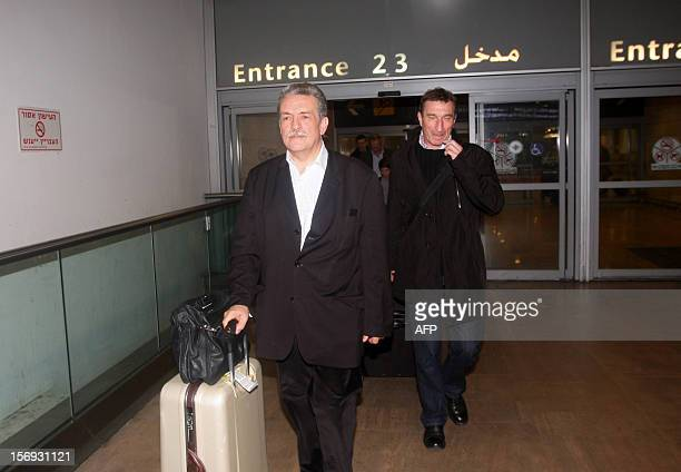OUT == A team of French doctors and forensics arrive at Ben Gurion airport near Tel Aviv on November 25 before heading to the West Bank city of...
