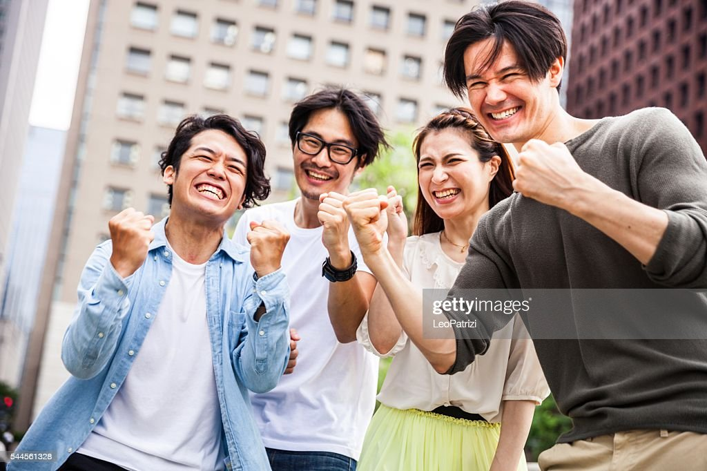 Team of friends cooperating together in Japan : Stock Photo