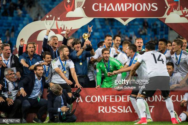 Team of German and Head Coach Joachim Loew celebrate with the trophy after the FIFA Confederations Cup final match between Chile and Germany at Saint...