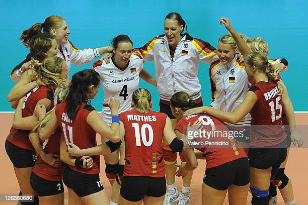 Team of Germany celebrate the victory against France at the end of the women Volleyball European Championship match between Germany and France on...