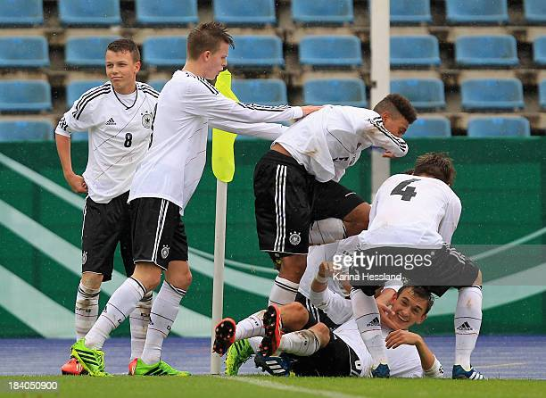 team of Germany celebrates the opening goal by Tim Probst during the friendly match between Germany and Russia at ErnstAbbeSportfeld on October 10...