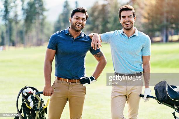 team of golfers - khaki trousers stock pictures, royalty-free photos & images