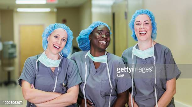 team of healthcare worker in hospital - female doctor stock pictures, royalty-free photos & images