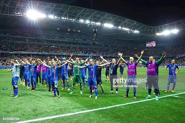 Team of Iceland celebrate at the end of the match during the European Championship match Round of 16 between England and Iceland at Allianz Riviera...