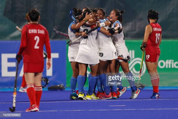 Team of India celebrate after a goal during the women's hockey pool B match between Korea and India on day seven of the Asian Games on August 25,...
