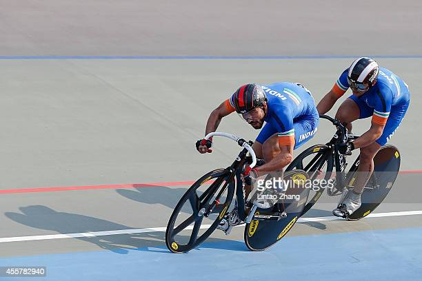 Team of India competes in Cycling Track Men's Team Sprint Qualifying during the 2014 Asian Games at Incheon International Velodrome on September 20...