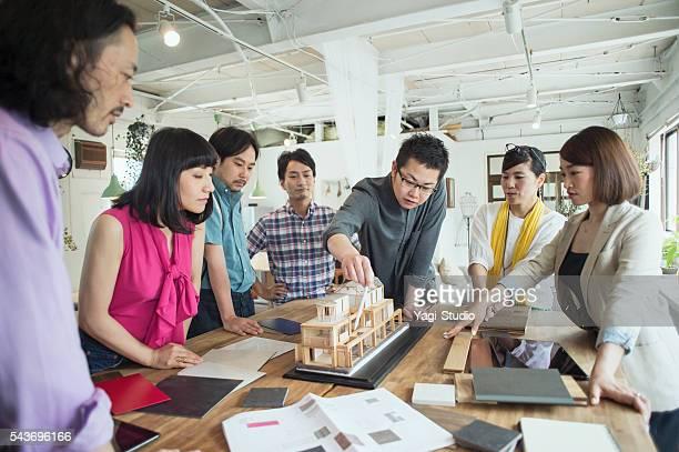Team of interior designers discussing in the studio