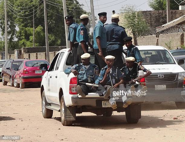 A team of Islamic sharia enforcers called Hisbah is on patrol in the northern Nigerian city of Kano in an open pickup on October 29 2013 The Hisbah...