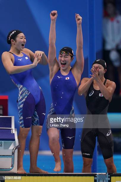 Team of Japan celebrate winning the final of the women's 4x100m freestyle relay swimming event on day one of the Asian Games on August 19 2018 in...