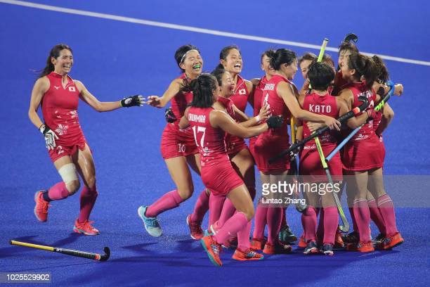 Team of Japan celebrates after winning the Hockey Women's Tournament Final match between Japan and India on day thirteen of the Asian Games on August...
