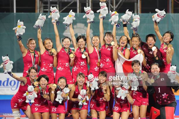 Team of Japan celebrates during the medal ceremony for the Hockey Women's Tournament Final match between Japan and India on day thirteen of the Asian...