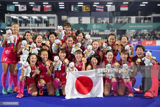 Team of Japan celebrates gold during the medal ceremony for the Hockey Women's Tournament Final match between Japan and India on day thirteen of the...