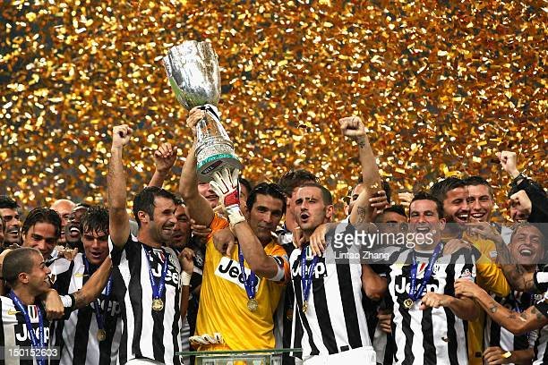 Team of Juventus FC celebrate with the trophy after winning the Italian Super Cup 2012 match against SSC Napoli at China's National Stadium on August...
