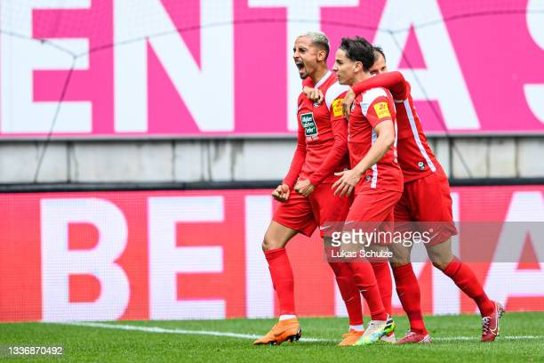 Team of Kaiserslautern celebrates their sites first goal scored by Kenny Prince Redondo during the 3. Liga match between 1. FC Kaiserslautern and FSV...