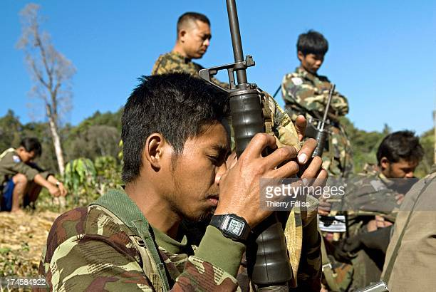 A team of Karen guerillas and Free Burma Rangers members many of whom are Christians is praying before going to a reconnaissance operation of a...