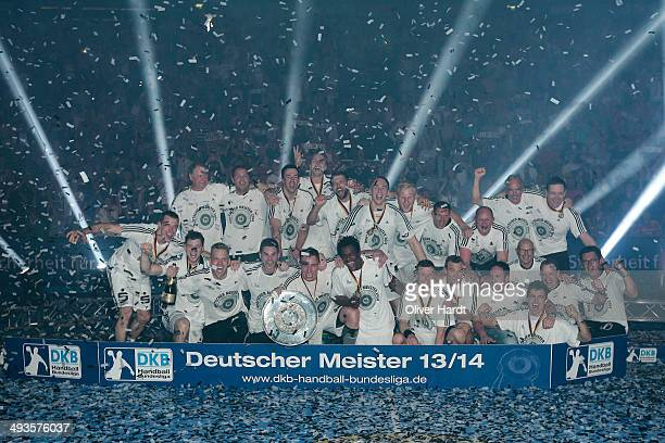 Team of Kiel celebrate with the trophy after the DKB HBL Bundesliga match between THW Kiel and Fuechse Berlin on May 24 2014 in Kiel Germany