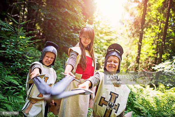 team of knights in forest - ritter stock-fotos und bilder