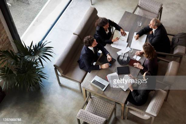 team of lawyers planning with business colleagues during meeting at law firm - lawyer stock pictures, royalty-free photos & images