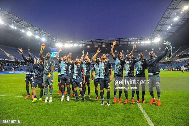 Team of Le Havre celebrates the victory with fans during the Ligue 2 match between Le Havre AC and Nimes Olympique on August 4, 2016 in Le Havre,...