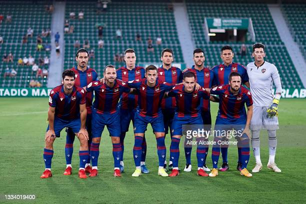 Team of Levante line up for a team photo prior to the pre-season friendly match between Levante UD and Elche CF at Estadio Martinez Valero on August...
