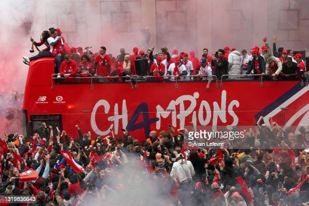 Team of Lille OSC celebrates with fans their League 1 championship trophy during a parade with the fans in a bus in down town on May 24, 2021 in...