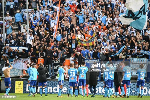 Team of Marseille celebrates the victory with fans during the Ligue 1 match between Amiens SC and Olympique Marseille at Stade de la Licorne on...