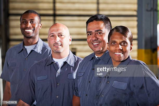 Team of mechanics in dark gray uniforms