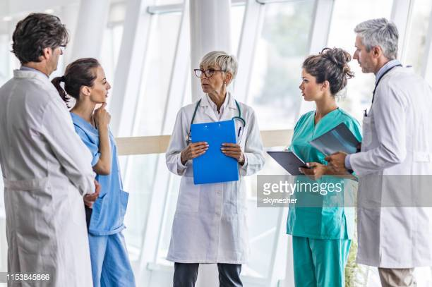 team of medical experts talking in a hospital. - scientific imaging technique stock pictures, royalty-free photos & images
