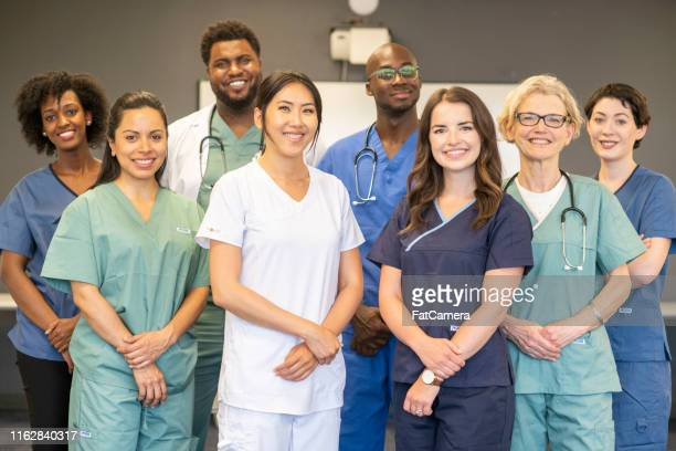 a team of medical professionals - nurse stock pictures, royalty-free photos & images