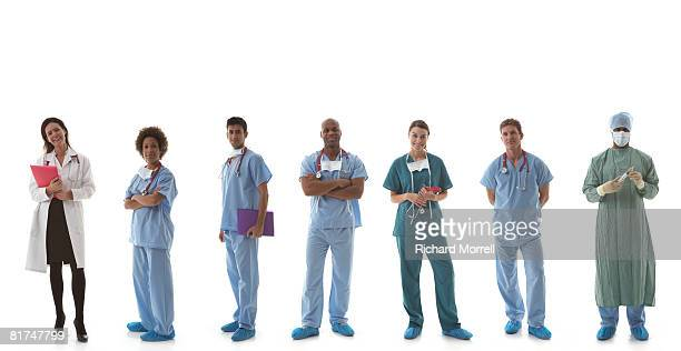 team of medical professionals - operating gown stock pictures, royalty-free photos & images
