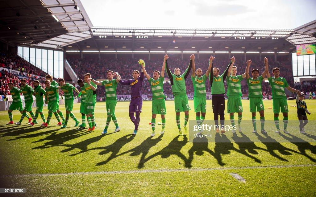 Team of Moenchengladbach celebrates after the Bundesliga match between 1. FSV Mainz 05 and Borussia Moenchengladbach at Opel Arena on April 29, 2017 in Mainz, Germany.