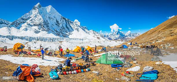 team of mountaineers at base camp high in himalayas nepal - base camp stock pictures, royalty-free photos & images