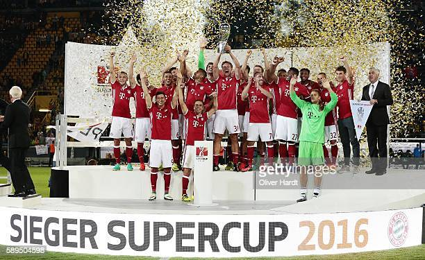Team of Munich celebrates with the Trophy after the DFL Supercup 2016 match between Borussia Dortmund and FC Bayern Muenchen at Signal Iduna Park on...